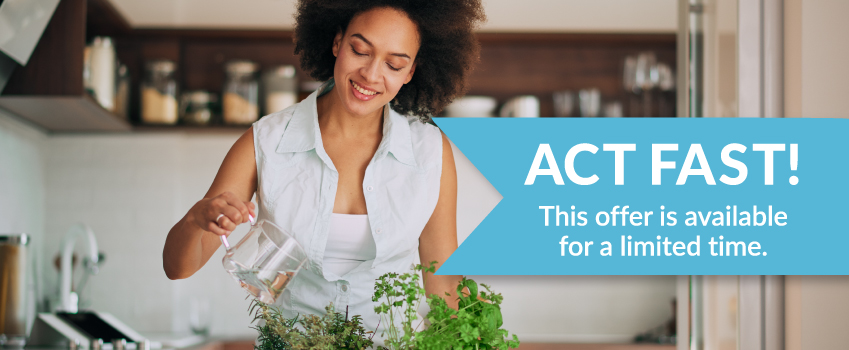 Woman watering plants - Act Fast! This offer is available for a limited time.