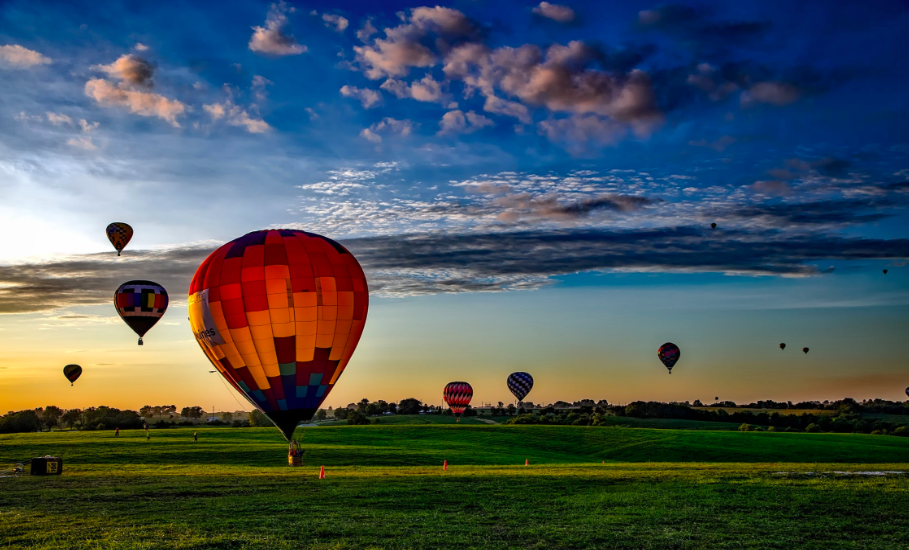 Hot air balloons taking off in the sky
