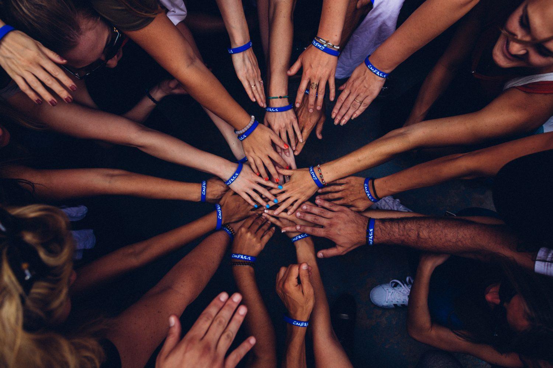 Group of hands huddled together